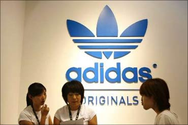 Customers at an Adidas store.
