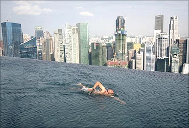 A man swims in the Infinity Pool atop the Marina Bay  Sands in Singapore.