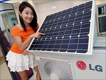 Hybrid air conditioner equipped with a solar cell module.