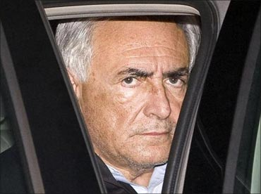Strauss-Kahn leaves the New York Police Department Special Victims Unit headquarters in Harlem.