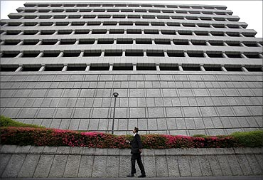 A man walks past the Bank of Japan headquarters building in Tokyo.