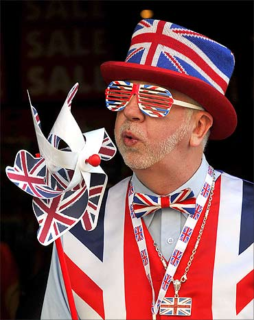 A man dressed in British union flag clothing promotes a souvenir shop in Piccadilly Circus.