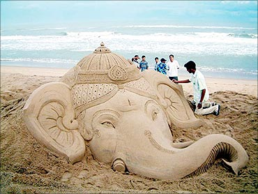 A sand sculpture of Lord Ganesha at Puri beach, Orissa.