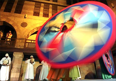 Whirling dervishes perform a traditional Sufi dance during a Ramadan night show in Old Cairo.