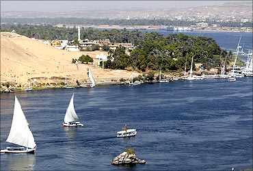 Traditional Egyptian Felucca boats sail on the Nile river in the southern Egyptian city of Aswan.