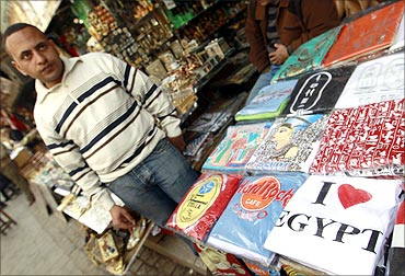 A street vendor stands outside of a store in the Khan al-Khalili area of Cairo.