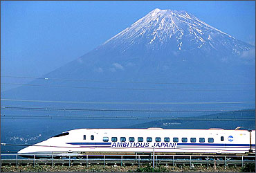 Japan's bullet train, or the shinkansen, speeds past Mount Fuji.