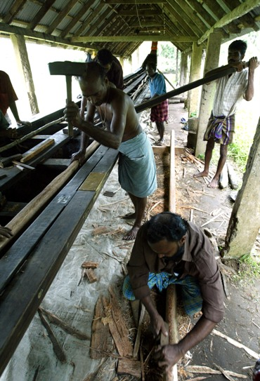 Workers give finishing touches to a boat on the eve of snake boat race at Alleppey near Kochi in Kerala.