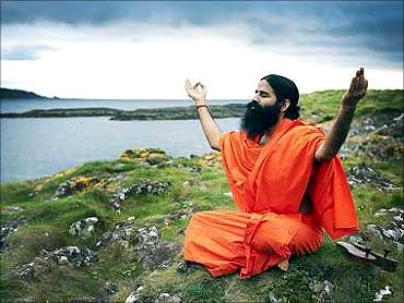 Baba Ramdev worships on Little Cumbrae during a hawan to bless the island.