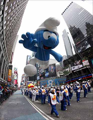 The Smurf balloon floats through Times Square.