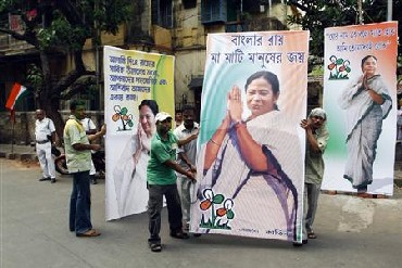 TMC supporters carry Mamata Banerjee's cutouts.