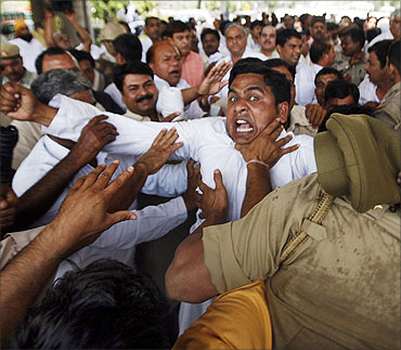 Farmers scuffle with police during a protest march at Noida.