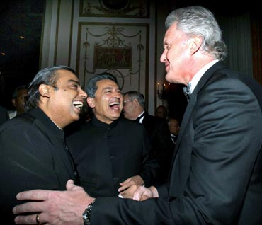 Rajat Gupta (center) and Mukesh Ambani share a joke with GE chairman Jeffrey Immelt.