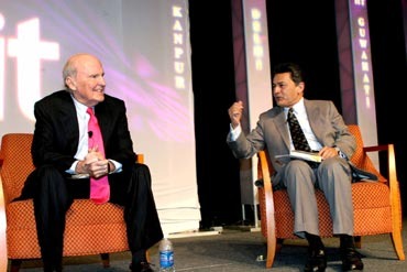 Gupta with former GE chairman Jack Welch (left).