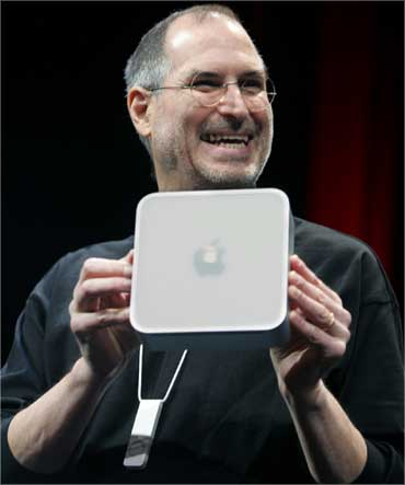 Jobs holds up Apple's Mini Mac computer on January 11, 2005.