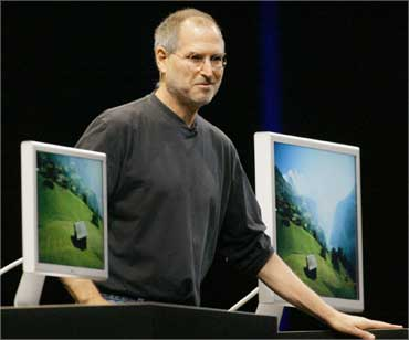 Jobs stands with several Apple flat panel displays on June 28, 2004.