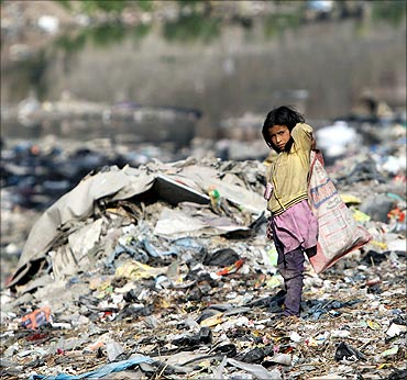 A child searches for recyclable material on the bank of Bagmati River in Kathmandu