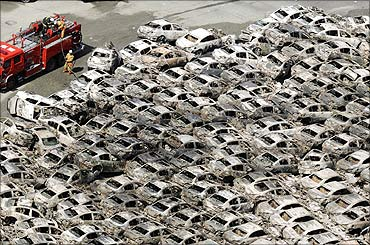 Burned-out cars are pictured at Hitachi Harbour in Ibaraki Prefecture.