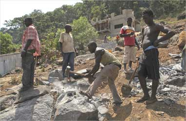 Labourers work at a construction site above Sierra Leone's capital Freetown.