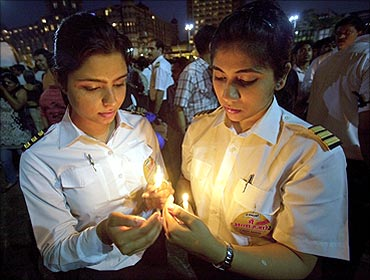 Pilots during a candlelight protest in Mumbai.