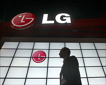 A man passes by a LG Electronics booth at a consumer electronics show.