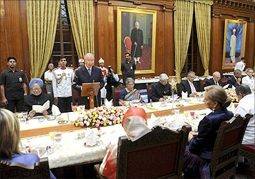 Belgium's King Albert II delivers a speech before an official dinner at the Rashtrapati Bhavan.