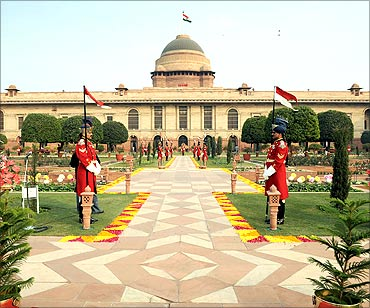 Guards stand in the Mughal gardens surrounding Rashtrapati Bhavan.