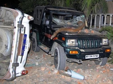 Vehicles lie damaged after an ethnic clash in Manipur.