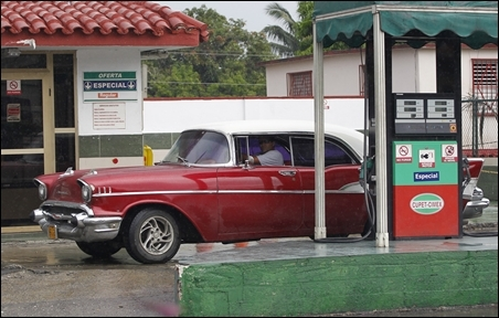 A Chevrolet 1957 Belair car is driven out of a gas station after refueling in Havana.