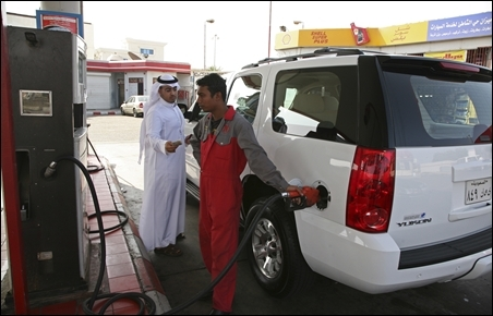 A station attendant fills up a car at petrol station in Jeddah.