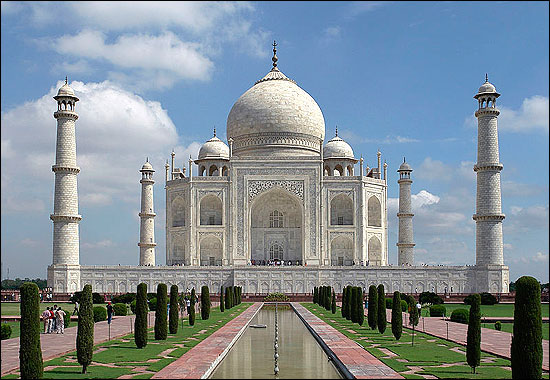 The Taj Mahal was built in Agra by Shah Jahan, a Mughal emperor, as a memorial to his deceased wife Mumtaz Mahal.