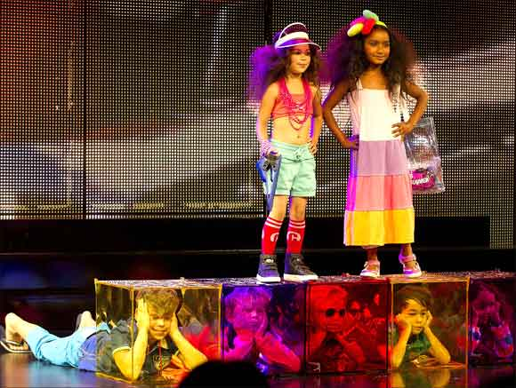 Child models present creations for the Spring/Summer 2012 collection at the Copenhagen International Fashion Fair for Kids.