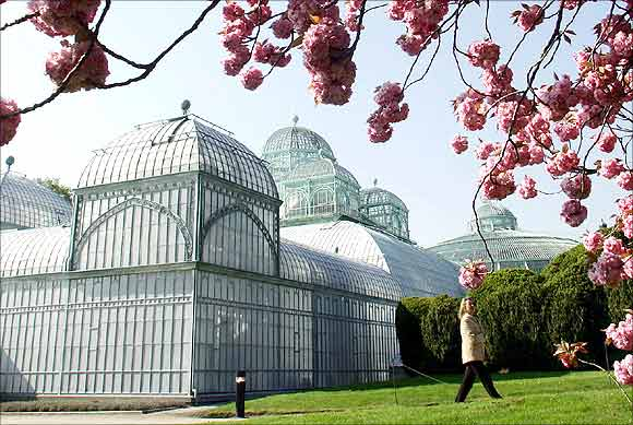A visitor walks past one of a hothouse on the grounds of the Belgian royal family's residence of Laeken in Brussels.