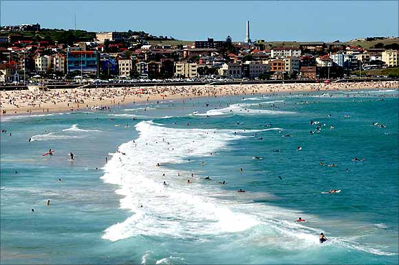 Thousands of beach goers enjoy the sun, sea and sand on Bondi Beach in Sydney.