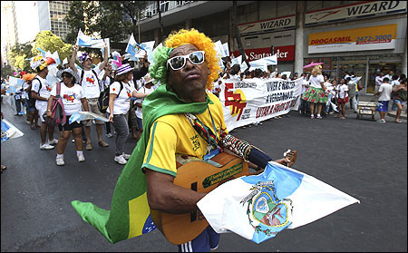 A man plays a guitar as he protests in downtown Rio de Janeiro against an oil reform amendment.