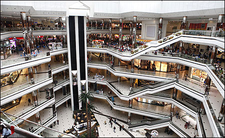 People stroll at a shopping mall in Istanbul.