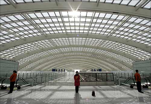 Airport staff at Beijing International Airport's new terminal.