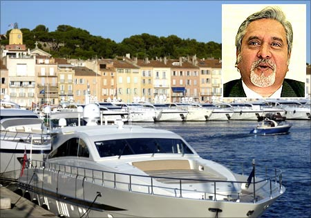 Docked luxury yachts are seen in Saint-Tropez harbour on the French Riviera. Vijay Mallya (inset).