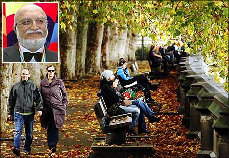 People enjoy Autumn sunshine in Victoria Tower Gardens in London. Vijaypat Singhania (inset).