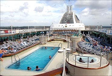 Tourists relax at the swimming pool on board a Princess Cruises liner.