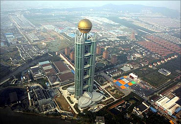The newly inaugurated skyscraper tower of Huaxi village is seen in Huaxi village.