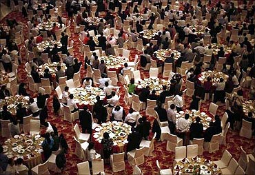 Guests attend a dinner at the new skyscraper tower of Huaxi village before its official inauguration.