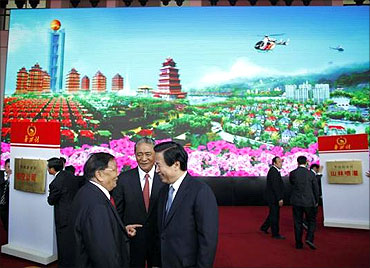 Officials attend the inauguration ceremony of the new skyscraper tower of Huaxi village.