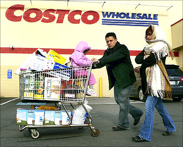 Shoppers leave Costco in Fairfax, Virginia.