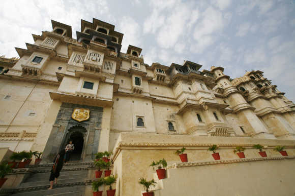 Tourists stand at the City Palace in Udaipur, Rajasthan.