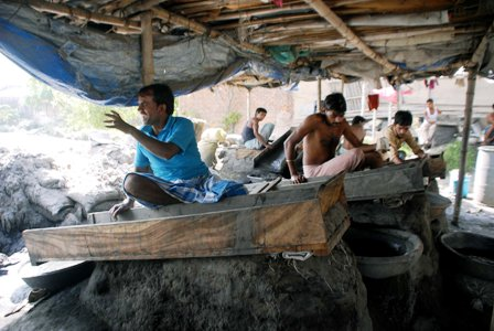 Workers at Bengal shanties are busy recovering gold from gold dust.