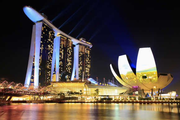 The Marina Bay Sands Hotel and ArtScience Museum is seen before Earth Hour in Singapore.