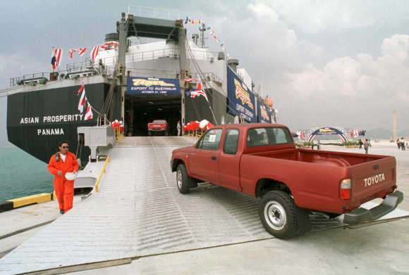 Toyota Hilux Tiger mini-trucks board a Panama-registered cargo ship at the deep-sea port of Laem Chabang on the Eastern seaboard of Thailand.