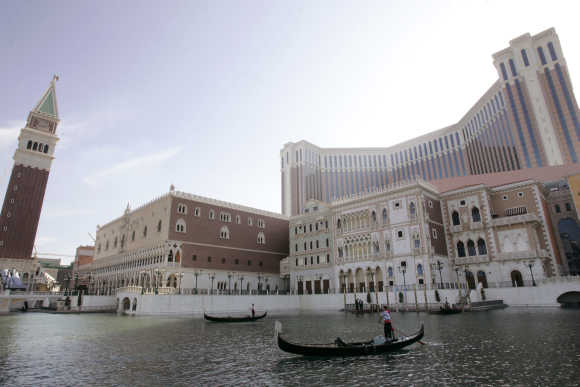 Performers steer their gondolas at the Venetian in Macau.