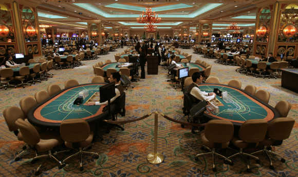 Employees prepare in the casino at the Venetian in Macau.
